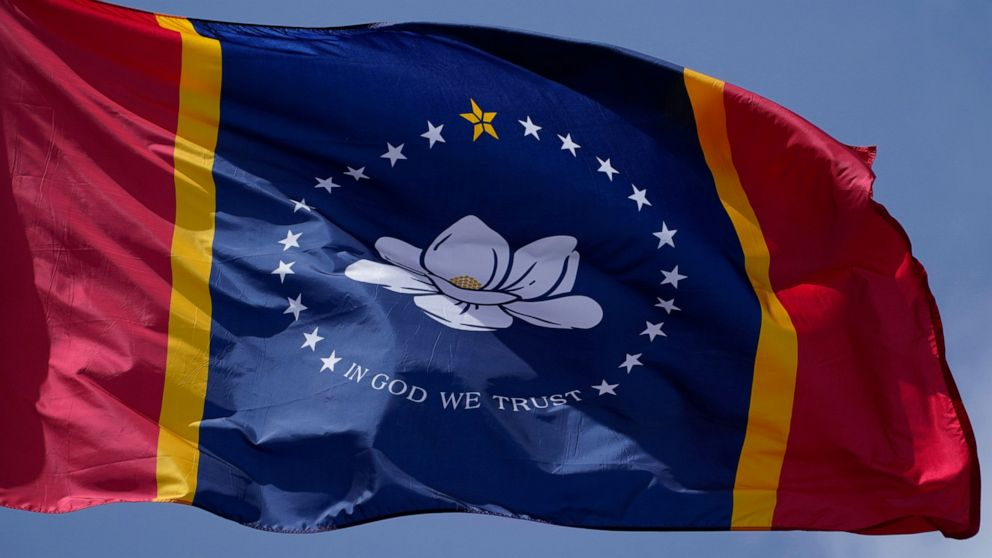 Mississippi governor signs law for flag without rebel emblem